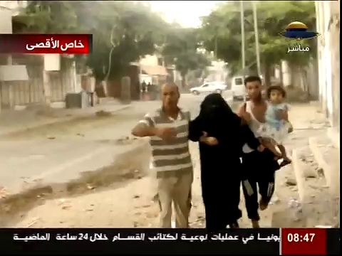 Gazan Civilians Flee massacre in Shujiya, August 2014.