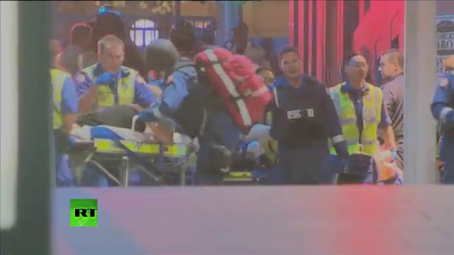 The Strange CPR performed by Special Operations Police Officer while paramedics wheel the trolley.