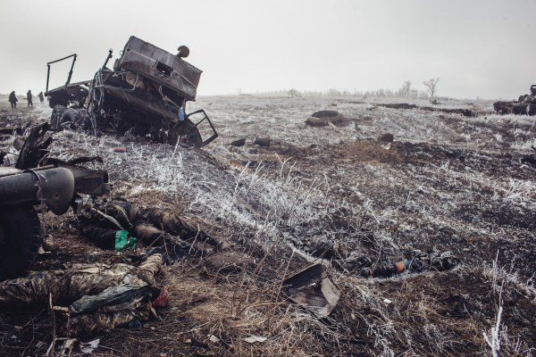 Destroyed Ukraine military vehicle with dead Ukraine soldier on the outskirts of Debalstseva. This is how it ended.