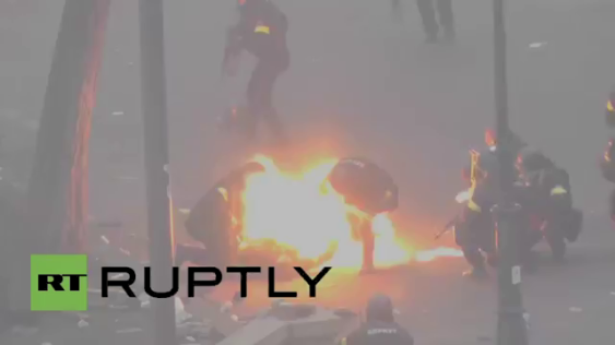 "Petrol bomb strikes a Uktaine police officer during the Maidan ""demonstrations"" a year ago."