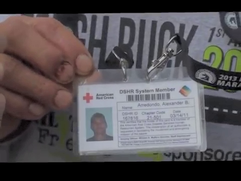 It is a custom for spectators at US sporting events to carry their Red Cross card around their neck to the event, right?