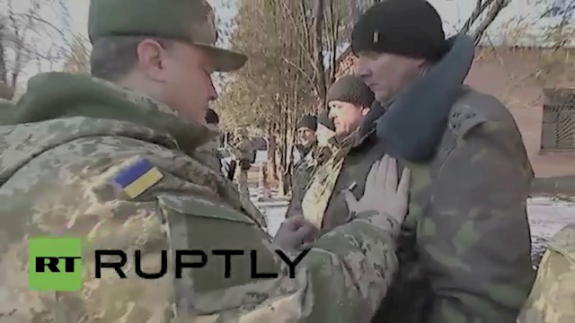 When all else fails... Poroshenko pins the Medal of Ukraine on the chest of the Ukraine Commander in Debaltseve.