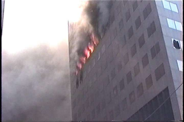 "This is a photo of WTC 7 on fire prior to it's destruction from a ""debunk"" website."