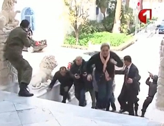 Civilians Scramble to safety in Tunis, March 18th, 2015.