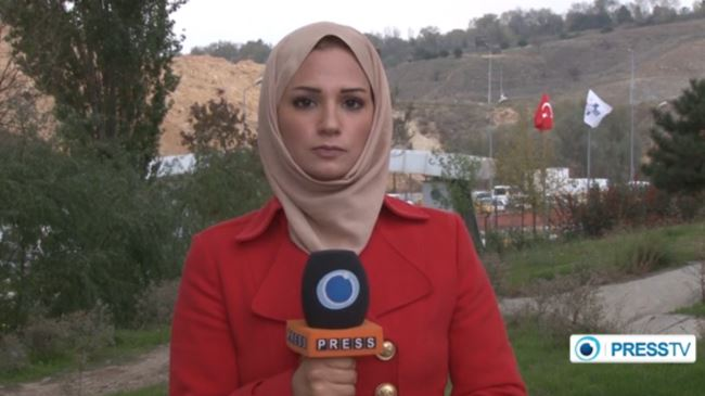 Serena Shim at the microphone for Press TV.