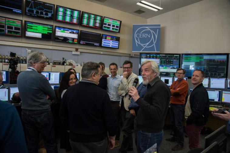Scientists and technicians in the LHC operations room.