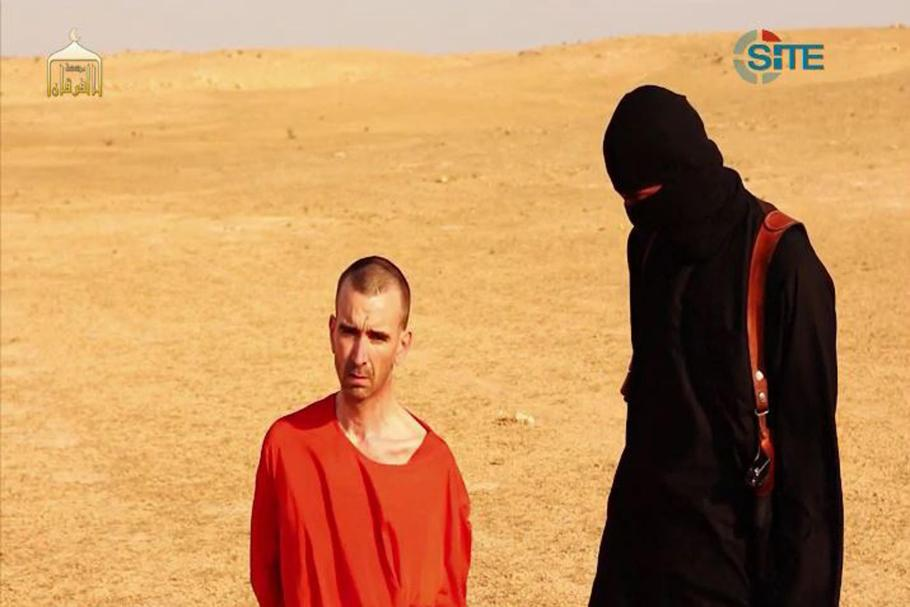 John with Peter Kassig prior to fake execution.