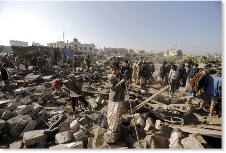 A young Yemeni surveys the devastation in the aftermath of A Saudi airstrike on his nation.