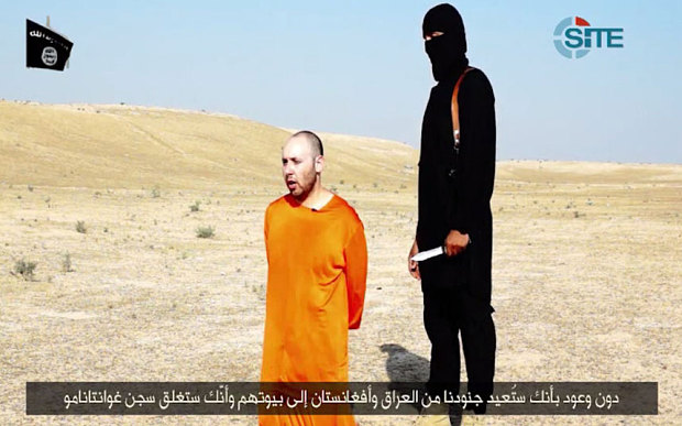 John with Steven Sotloff prior to the most hilarious of John's fake killings due to Sotloff's terrible speech.