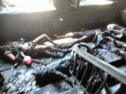 People died in the fires, many others emerged from the fires only to be murdered by thugs in full view of the police.