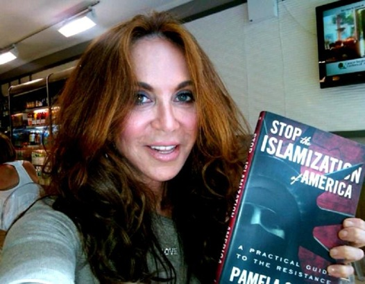 High quality individual Pamela Geller displays one of her fine works of literature alongside her admirable visage.