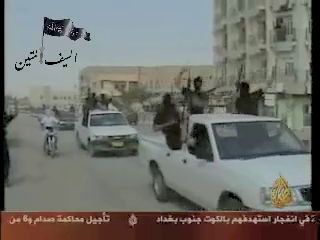 The Islamic State of Iraq celebrate their inception by driving through Central ramadi in late 2006