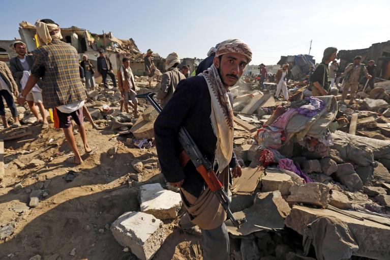 Citizens of Yemen survey the destruction.