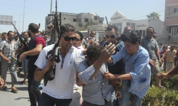 This photograph shows one of the alleged gunmen in the Sousse massacre in custody..