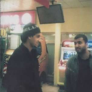 The original covert photograph of Khan and Tanweer in 2003.