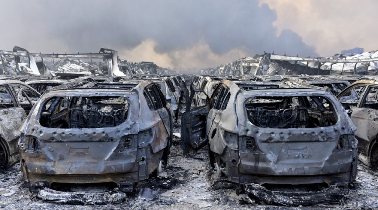 The cars in Tianjin show the signs of having been struck by a Thermal wave associated with a Nuclear blast, the premature corrosion giving a rusted appearance is one strong tell-tale sign.