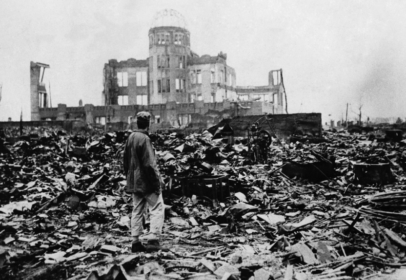 A man stands in the ruins of Hiroshima following the US nuclear attack of August 6th, 1945.