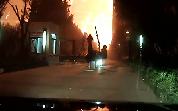 Dashcam footage of the prelude to the massive blast in Tianjin, China August 12th, 2015.