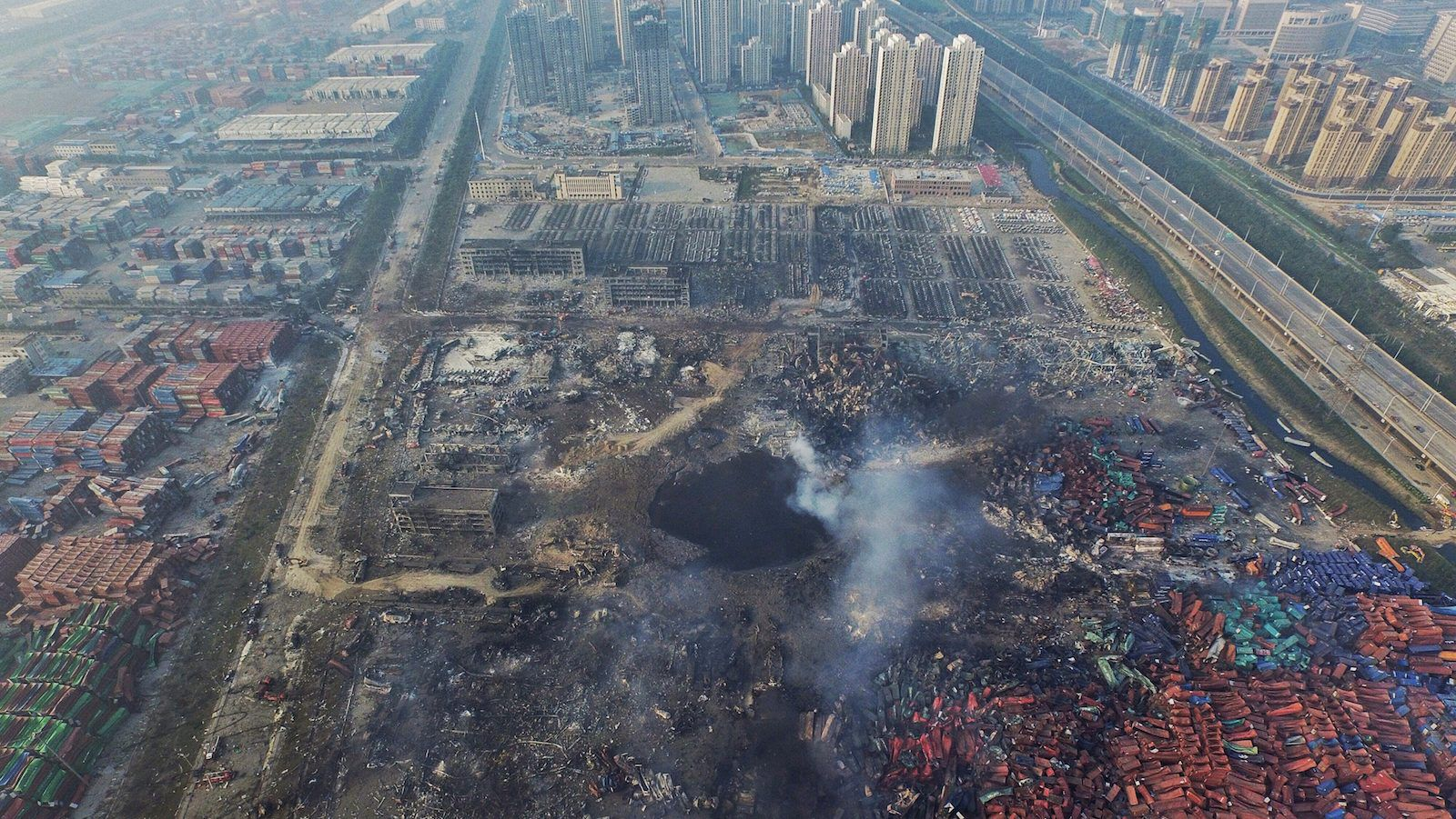 Total devastation and the fires are still burning. Aftermath of Tianjin blasts echoes the aftermath