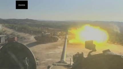 Russian operated tank fires into the Latakia hills.