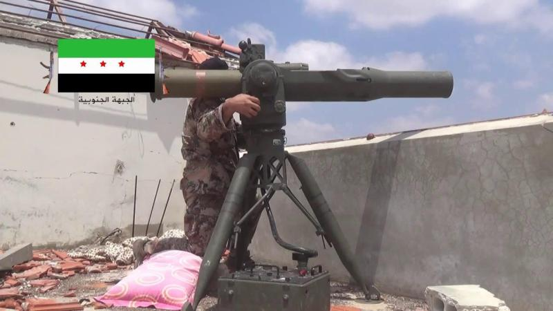 Stock image of a Syrian rebel fighter preparing to fire anti tank rocket from a concealed position.