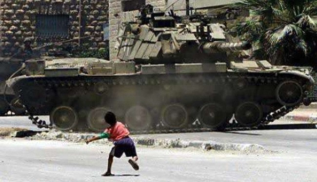 Classic image of the conflict in Palestine but a sonte throwing child will never defeat a tank in the field of battle.