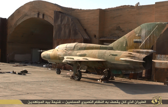 Abandoned MIg war planes inside the Taquba Airbase after it was over run by ISIL in 2014.