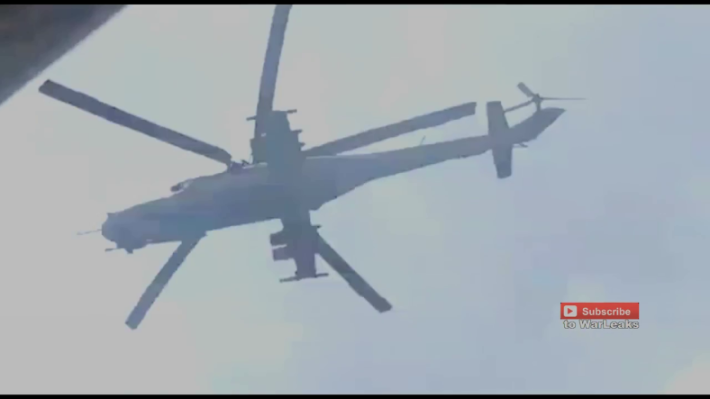 Amazing rebel footage shows the MI24 helicopter flying extremely low under heavy machine gun fire.