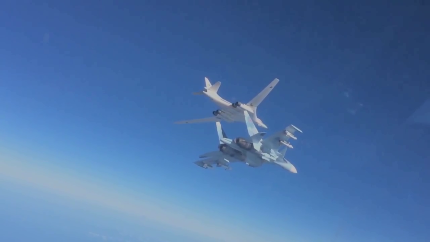 Su30 fighter escorts TU 160long range bomber.