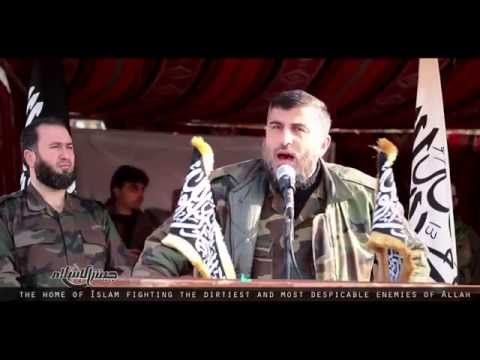 Zahran Alloush addresses a Jaish al islam military parade in the Damascus countryside in April 2015.