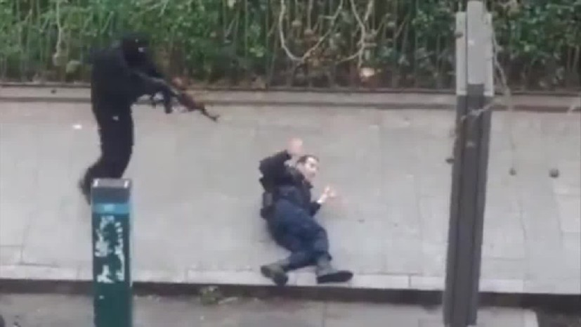 Phot of the year 2015. Pretend terroirst pretend killing of a frenchmen pretending to be a police officer, Paris, January 7th, 2015.