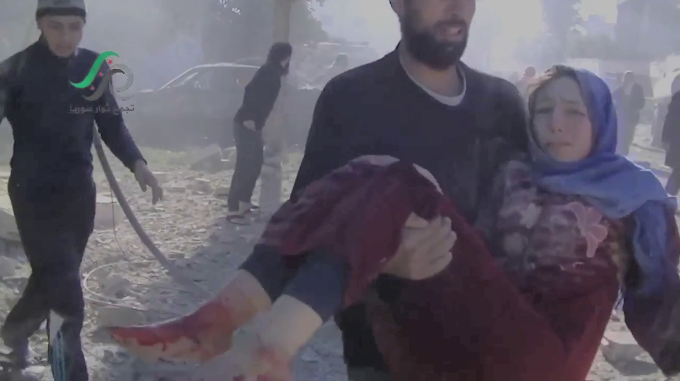 CIvilsain wounded in Russian/Syrian strike is rescued from destroyed byilding in Hama province, January 2016.