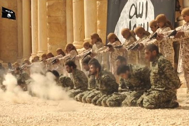"ISIS geniuses were unsure whether to destroy Palmyra or use it as the site for mass executions to make them look ""epic"" in the end they compromised, doing a little of both. Here the ""children's battalion"" massacre a group of captured Syrians."