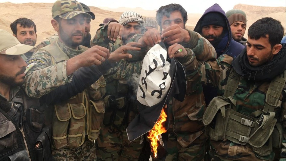 The Syrian Army burns the flag of ISIS after the liberation of Palmyra.