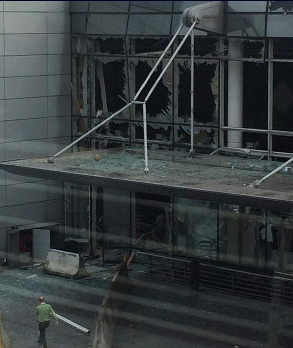 Damage to a building that is part of the Zaventem Airport complex following reported explosions.