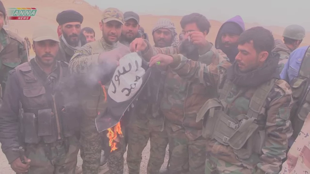 Syrian Army with ISIS flag in Palmyra, March 2016.