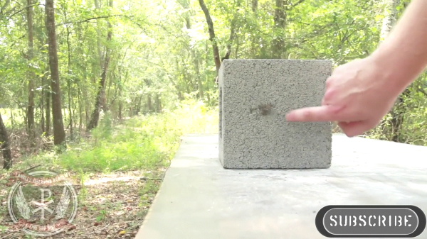 A concrete block after a standard steel jacketed bullet from a 9mm, pistol has been fired into it.