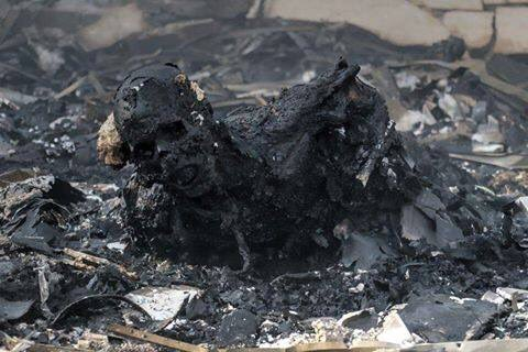 The charred remains of a human being on the ground at the Sana'a community hall where more than 140 people were slaughtered by Gulf coalition aircraft on October the 8th, 2016.