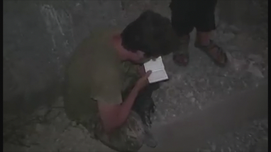 Pinned down by heavy artillery fire from the Syrian Army, one fighter consults the Koran for what may be the final time.