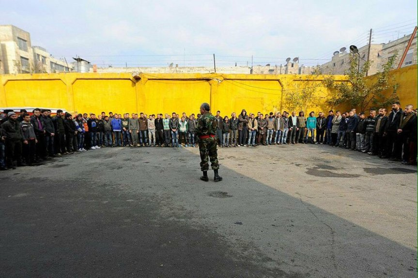 Mass surrender:defeated insurgents lay down their arms en masse in east Aleppo December 12th, 2016.