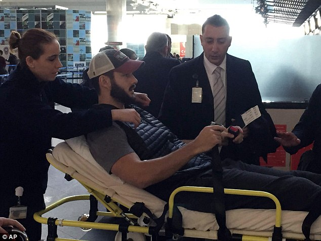 Jacob Raak leaves hospital and his thin, skin tight pants make it clear that there are no bandages on his right leg less than two days after being shot by an assault rifle.